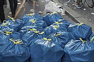 Germany, Berlin, Kreuzberg, bin bags after demonstation on 1st of May - TAMF000082