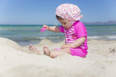 Spain, Majorca, baby girl playing on the beach - ROMF000061