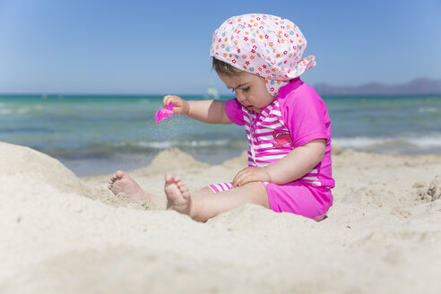 Spain, Majorca, baby girl playing on the beach - ROMF000061
