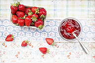 Glass of strawberry jam and box of strawberries - LVF003561