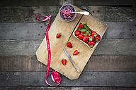 Glass of homemade strawberry jam, ribbon and box of strawberries - LVF003547