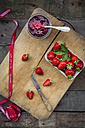 Glass of homemade strawberry jam, ribbon and box of strawberries - LVF003545