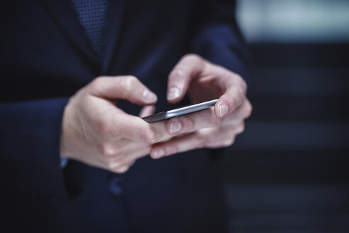 Hands of businessman holding smartphone - PRA000038