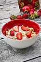 Granola, popped amarant and strawberries in bowl - LVF003576