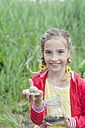 Germany, Girl holding snail - MJF001533