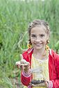 Germany, Girl holding snail - MJF001533