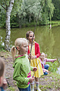 Germany, Girls with rods and small fish - MJF001540