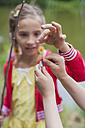 Germany, Girl with rod and small fish - MJF001543
