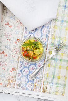 Glass of couscous salad and fork on tray - LVF003596