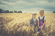 Germany, Saxony, two children standing in a grain field - MJF001578