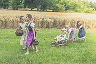 Germany, Saxony, five children with trolley on a meadow - MJF001588