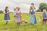 Germany, Saxony, children in traditonal clothes dancing on a meadow - MJF001628