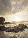Spain, Galicia, Ribadeo, Playa de Aguas Santas at sunset - LAF001412