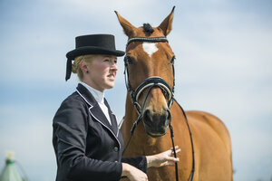 Portrait of dressage rider and horse - TAMF000229