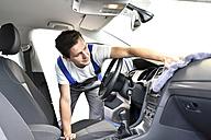 Man cleaning car interior - LYF000425