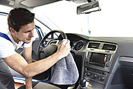 Man cleaning car interior - LYF000427