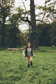 Little girl running on a meadow in a park - CHAF000245