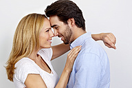 Portrait of loving couple in front of white background - CHAF000263