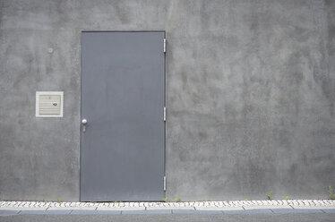 Grey steel door at concrete wall - GUFF000125