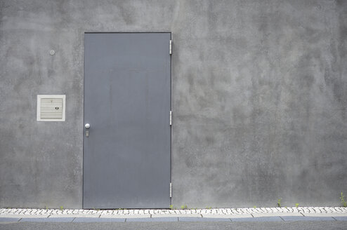 Grey steel door at concrete wall - GUFF000125