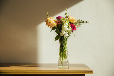 Small bouquet of summer flowers on old wooden sideboard - MFF001663