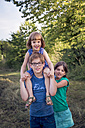 Portrait of boy with his two sisters - LVF003634