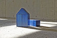 Model house made of building bricks on a construction site - FMKF001584