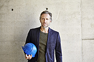Portrait of confident architect on construction site - FMKF001644