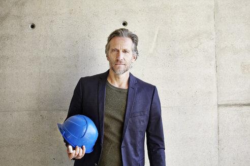 Portrait of confident architect on construction site - FMKF001644