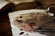 Letter on parchment paper with blood drops, fallen whiskey glass and quill - MID000482