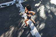 Spain, Barcelona, jogging young woman - EBSF000723
