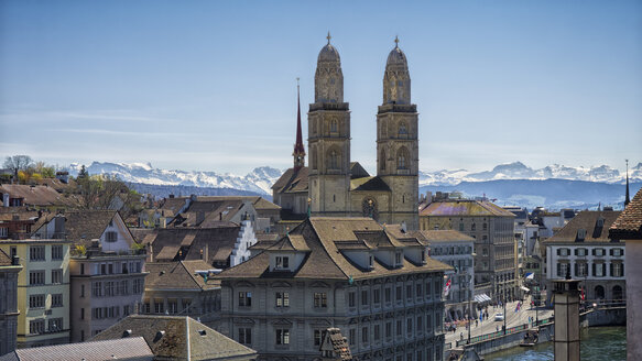 Switzerland, Zurich, View to Great Minster and Alps in the background - KRPF001517