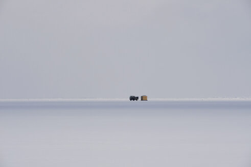 Russia, Lake Baikal, pickup truck on frozen lake beside hut for ice fishing - GNF001355