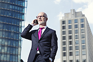 Germany, Berlin, Potsdam Square, business man with mobile phone - TAM000257