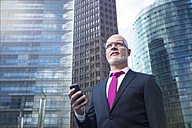 Germany, Berlin, Potsdam Square, business man with mobile phone - TAM000258
