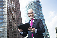Germany, Berlin, Potsdam Square, business man with digital tablet - TAM000259