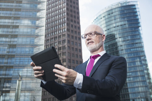 Germany, Berlin, Potsdam Square, business man with digital tablet - TAM000260