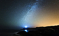 Spain, Valdovino, starry sky with milky way and shooting star above the Galician coast - RAEF000228