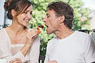 Couple having breakfast on balcony - MFF001698