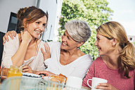 Three women at breakfast table on balcony - MFF001706