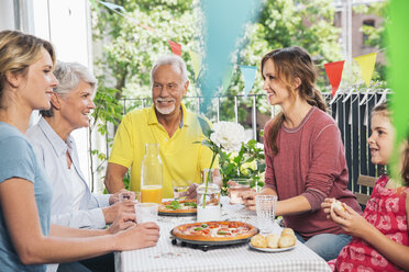 Three generations family talking on balcony - MFF001708