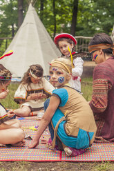 Germany, Saxony, Indians and cowboy party, Girls tinkering with beads - MJF001635