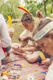 Germany, Saxony, Indians and cowboy party, Girls tinkering with beads - MJF001637