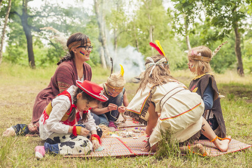 Germany, Saxony, Indians and cowboy party, Girls tinkering with beads - MJF001644