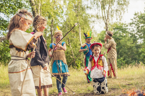 Germany, Saxony, Indians and cowboy party, Children rasting marshmallows on sticks - MJF001676
