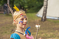 Germany, Saxony, Indians and cowboy party, Girl with roasted marshmallow on stick - MJF001664