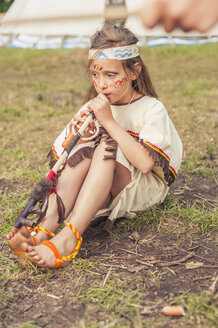 Germany, Saxony, Indians and cowboy party, Girl smoking pipe of peace - MJF001670
