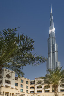United Arab Emirates, Dubai, residential area at Souk al Bahar with Burj Khalifa in the background - NKF000274