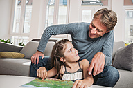 Father and little daughter with map in the living room - MFF001689