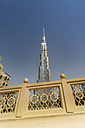 United Arab Emirates, Dubai, Burj Khalifa seen from the Souk al Bahar bridge - NKF000262